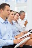 hålla ögonen på för presentation för affärsgrupp Royaltyfri Bild