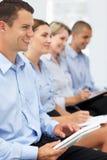 hålla ögonen på för presentation för affärsgrupp Arkivbild