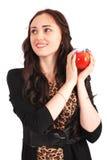 Hållande äpple för tonårig flicka Arkivfoto