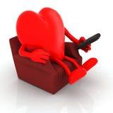 Hållande ögonen på television för röd hjärta från soffan med fjärrkontroll Arkivbilder