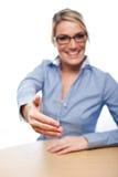 Hållande affärskvinna ut hennes hand i hälsning royaltyfria foton