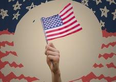 Hållande amerikanska flaggan för hand mot kräm- cirkel och den hand drog amerikanska flaggan Royaltyfria Foton