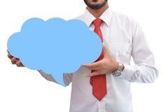 Hållande anförandebubbla för man i hand Arkivfoto