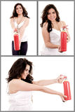 Hållande brandsläckareuppsättning för kvinna fotografering för bildbyråer