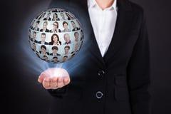 Hållande businesspeoplecollage för affärskvinna i sfär Arkivbild