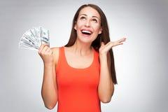 Hållande dollarräkningar för kvinna Royaltyfri Fotografi