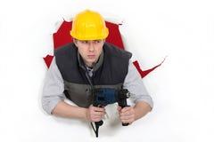 Hållande drillborr för byggmästare Arkivbild