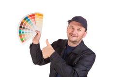 Hållande färgpalett för man Arkivfoto