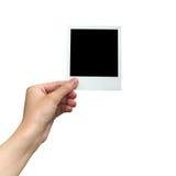 Hållande fotoram för hand på isolerad vit med den snabba banan arkivfoton