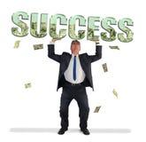 Hållande FRAMGÅNG för affärsman som fylls med pengar Arkivbilder