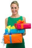 Hållande gåvor för kvinna Royaltyfria Bilder