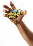 Hållande glass bild för hand av bilen Arkivfoton
