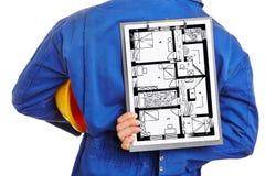 Hållande golvplan för arbetare av huset Fotografering för Bildbyråer