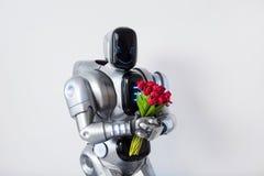 Hållande grupp för nöjd robot av blommor arkivbild