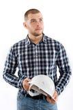 Hållande hardhat för byggnadsarbetare arkivfoton