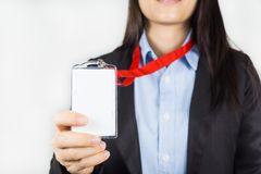 Hållande identitetskort för kvinna royaltyfria foton