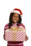 Hållande julgåva för ung jamaican flicka Royaltyfri Fotografi