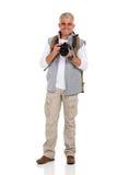 Hållande kamera för fotvandrare Arkivbilder