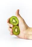 Hållande kiwifruit för hand arkivbilder