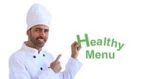 Hållande kock övre ett tecken som säger den sunda menyn Arkivfoto