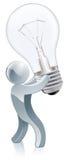 Hållande lightbulb för person Royaltyfria Bilder