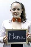 Hållande menybräde för ung servitris i händer Royaltyfri Foto