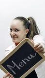 Hållande menybräde för ung servitris i händer Fotografering för Bildbyråer