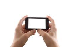 Hållande mobil smartphone med den tomma skärmen Royaltyfri Bild