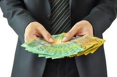 Hållande pengar för affärsman - australiska dollar Royaltyfri Foto