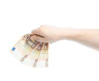 Hållande pengar för Caucasian manlig hand Arkivbilder