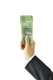 Hållande pengar för hand - australiska dollar Fotografering för Bildbyråer