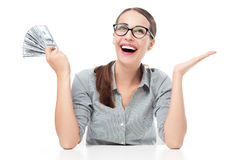 Hållande pengar för upphetsad kvinna Fotografering för Bildbyråer