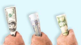 Hållande pengar fast Arkivbild