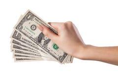 Hållande pengardollar för kvinnlig hand som isoleras på vit bakgrund Arkivbild