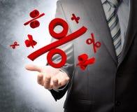 Hållande procentsatstecken för affärsman Arkivfoto
