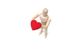 Hållande röd hjärta royaltyfri foto