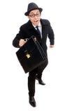 Hållande resväska för ung man Arkivfoton