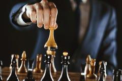 Hållande schack för hand royaltyfri fotografi
