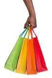 Hållande shoppingpåsar för manlig hand Arkivbilder