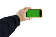 Hållande smartphone för hand med den tomma skärmen Arkivbild