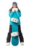 Hållande snowboard för kvinna i studio Arkivbild