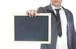 Hållande svart tavla för affärsman Royaltyfri Foto