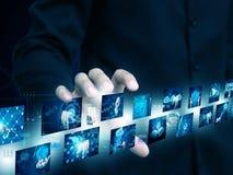 Hållande teknologi för affärsman royaltyfria bilder