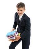 Hållande tunga läroböcker för student Royaltyfri Foto