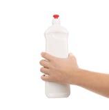 Hållande vit plast- flaska för hand Arkivbild