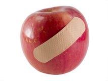 håller den away dagdoktorn för äpplet Fotografering för Bildbyråer