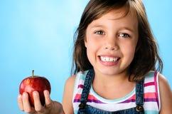 håller den away dagdoktorn för äpplet arkivbild
