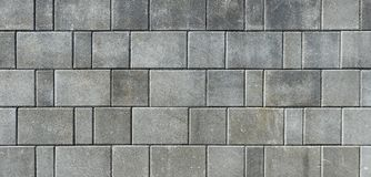 Hårdna eller lappa gråa trottoartjock skiva eller stenar för golv som är wal fotografering för bildbyråer