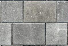 Hårdna eller lappa gråa trottoartjock skiva eller stenar för golv som är wal arkivbild