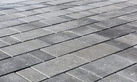 Hårdna eller lappa gråa trottoartjock skiva eller stenar för golv som är wal arkivfoton